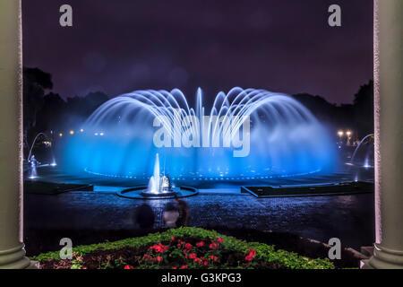 Blue illuminated fountain at night, Park of the Reserve (Parque de la Reserva), Lima, Peru - Stock Photo