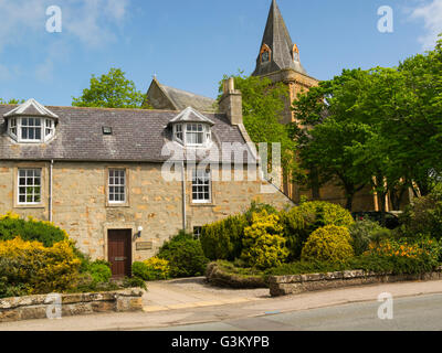 Lovely stone cottage in front of Dornoch Cathedral Sutherland Scottish Highlands a former Royal Burgh a historic - Stock Photo