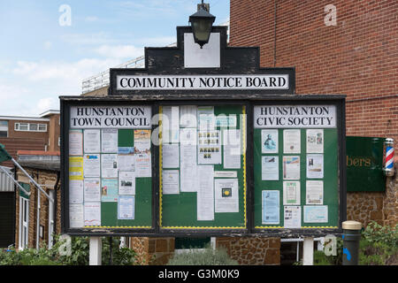 A community notice board with posters at Hunstanton UK - Stock Photo