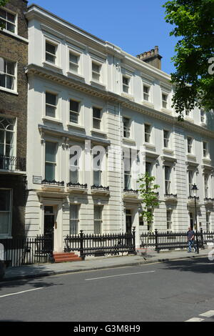 Tall Georgian houses located near Bloomsbury square in London - Stock Photo