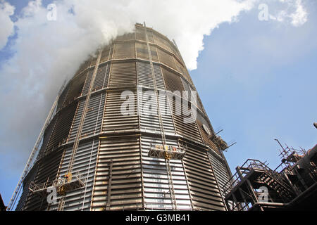 Steam engulfs the top of a steel gas holder at Redcar Steelworks. Taken in 2008 before closure of the plant. - Stock Photo