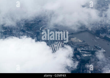 London, UK. 13th June 2016. An aerial photograph over London Shard partially covered by clouds on an overcast wet - Stock Photo