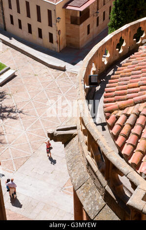 Tourists taking photos in the street, view from the terrace of the cathedral. Salamanca, Spain. - Stock Photo