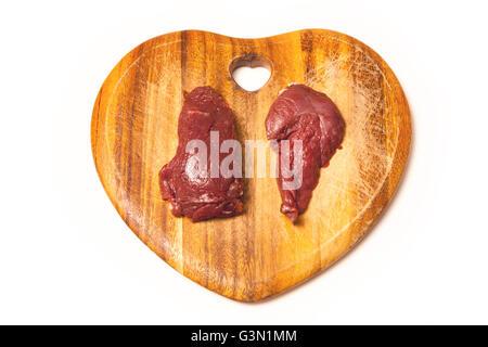 Uncooked kangaroo meat steaks  isolated on a white studio background. - Stock Photo
