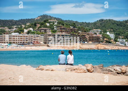 Foreign tourists admiring panorama of Tossa de Mar, Spain, on May 24, 2016 - Stock Photo
