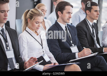 Business group of people making notes during a meeting conference - Stock Photo