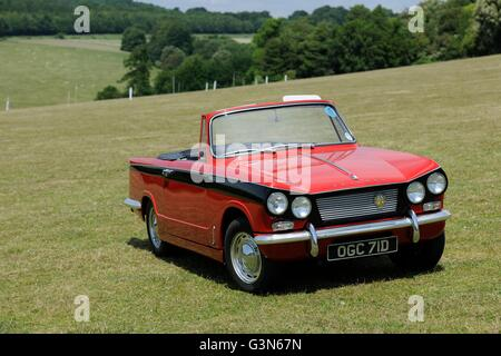 Triumph Vitesse convertible standing in a field on a sunny day - Stock Photo