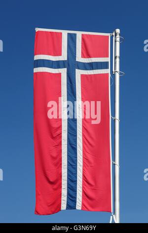 Norwegian flag waving in the sky - Stock Photo
