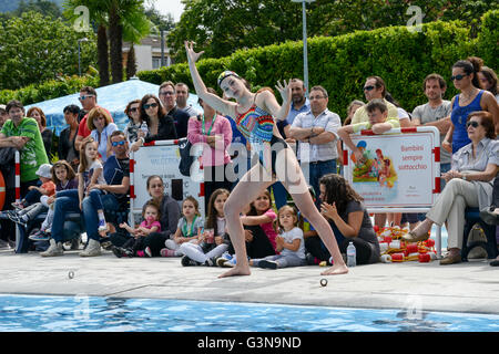 Massagno, Switzerland - 12 June 2016 - Girl in a pool practicing synchronized swimming - Stock Photo