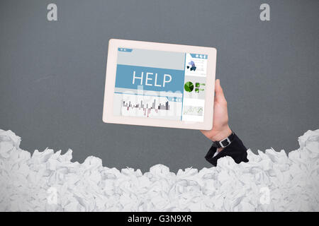 Composite image of masculine hand holding tablet - Stock Photo