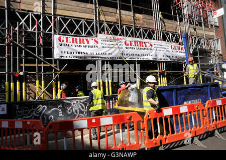 Workmen on a scaffolding site in Old Compton Street, Soho, London, England, UK - Stock Photo