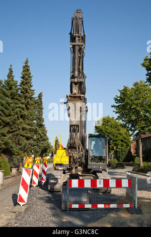 Excavator for road construction work, renewal of the sewerage system, Koenigstrasse, Kamen, Ruhr Area, North Rhine - Stock Photo