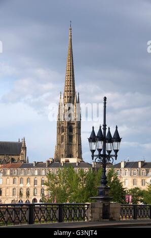 The old bridge Pont de Pierre, tower of church Eglise Saint Michel, Bordeaux city, Aquitaine, Gironde, France, Europe - Stock Photo