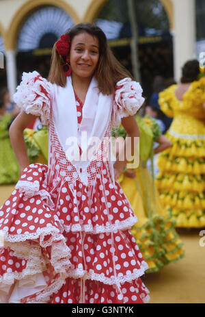 Spain, South Andalusia, Jerez Horse Fair, held annually in May, a pretty Spanish Brunette,  dressed in Flamenco - Stock Photo