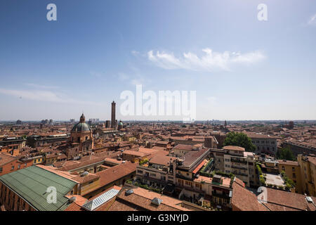 Views over the red terracotta tiled rooftops of Bologna Italy - Stock Photo