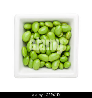 Green soy beans in a square bowl isolated on white background - Stock Photo