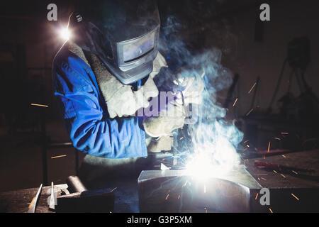 Welder cutting metal - Stock Photo