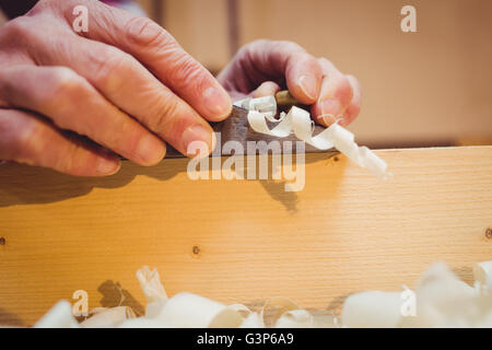 Close-up of wood shavings being pulled out - Stock Photo