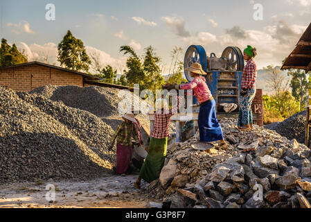 Woman workers work in a quarry - Stock Photo