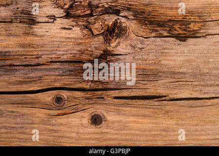 Partly rotted, cracked timber detail. - Stock Photo