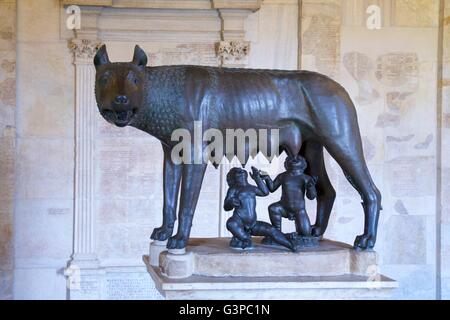 Bronze statue of she-wolf with Romulus and Remus,  Palazzo dei Conservatori,  Capitoline Museum, Rome, Italy - Stock Photo