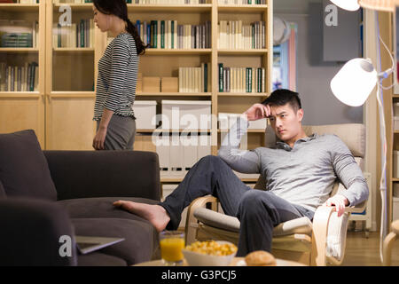 Angry couple in living room - Stock Photo