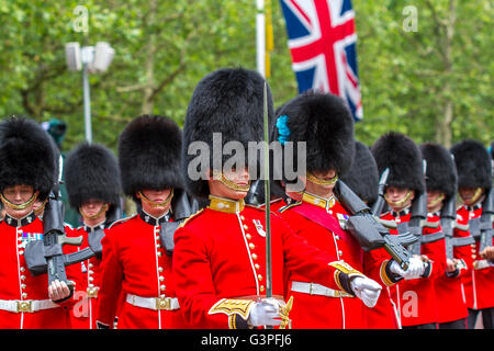 Irish Guardsmarching at The Queens Birthday Parade 2016 ,also known as The Trooping Of The Colour , The Mall , London - Stock Photo