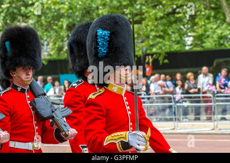 Irish Guards marching along The Mall at  Trooping Of The Colour / The Queens Birthday Parade 2016 , London - Stock Photo