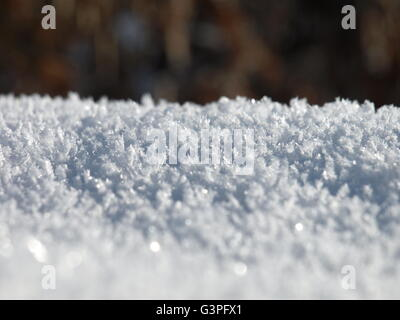 snow crystals reflecting the sun - Stock Photo