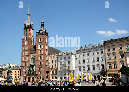 St Mary's Basilica, Old Market Square Krakow, Poland - Stock Photo