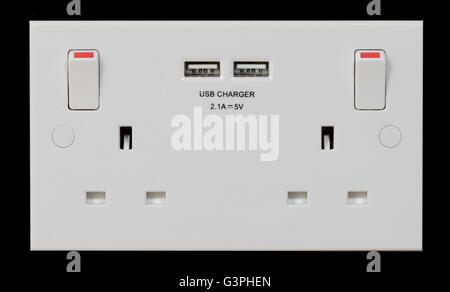 UK double plug socket with built in USB charger - Stock Photo