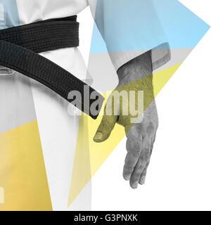 Close-up of karate black belt on white uniform - Stock Photo