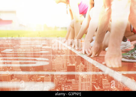 Composite image of side view of cropped people ready to race on track field - Stock Photo