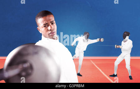 Composite image of swordsman practicing with fencing sword - Stock Photo