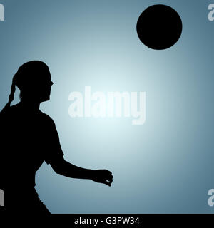 Composite image of woman soccer player waiting the ball - Stock Photo