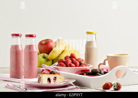 Breakfast. Strawberry cake and coffee, fruit and berries strawberry and banana smoothies. Selective focus. - Stock Photo