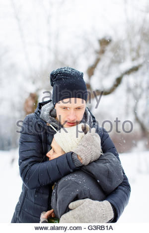 Sweden, Sodermanland, Jarna, Adult son hugging mother in park - Stock Photo