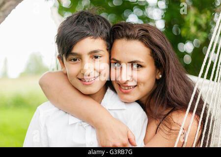 Sweden, Varmland, Filipstad, Gasborn, Horrsjon, Portrait of mother with son (10-11) - Stock Photo