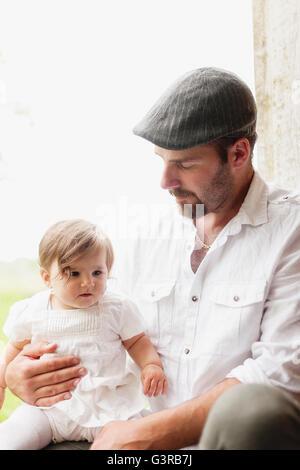 Sweden, Varmland, Filipstad, Gasborn, Horrsjon, Portrait of man with baby girl (12-17 months) - Stock Photo