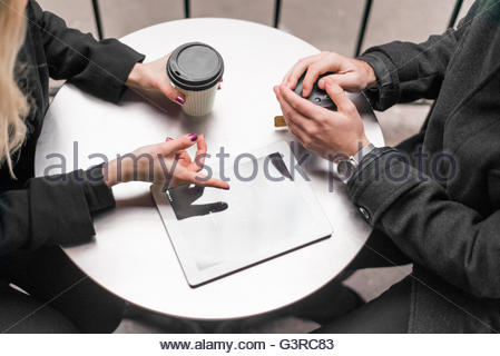 Sweden, Woman´s hand pointing at digital tablet - Stock Photo