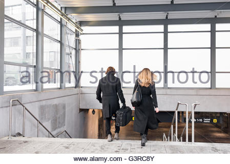 Sweden, Skane, Malmo, Rear view of couple entering subway station - Stock Photo
