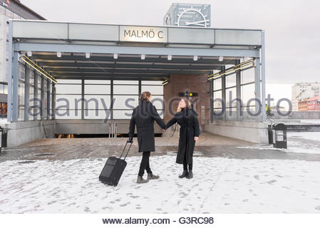 Sweden, Skane, Malmo, Couple holding hands in city - Stock Photo