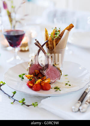 Sweden, Lamb chops and french fries on table - Stock Photo