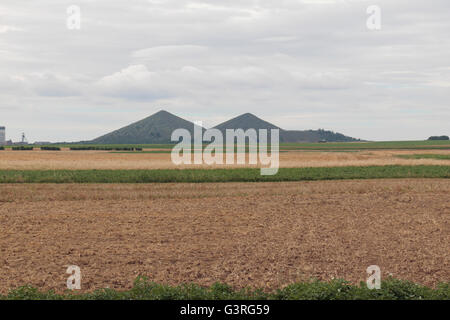 The twin heaps of Loos-en-Gohelle visible from the CWGC St Marys Advanced Dressing Station Cemetery, Haisnes, France. - Stock Photo