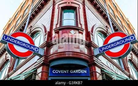 London, UK - June 6, 2016 - Covent Garden station and iconic signs for the London's underground transportation system. - Stock Photo