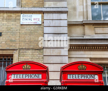 The iconic red telephone booths and street sign on Broad Court, Covent Garden, London - Stock Photo