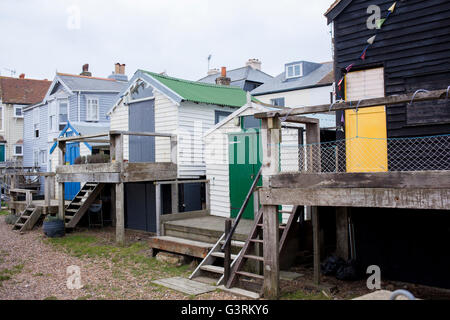 A row of beach and fishing huts along the front in the Kentish fishing town of Whitstable - Stock Photo