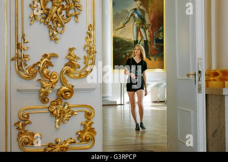 Saint Petersburg Russia. Hermitage Museum in the Winter Palace. Through doorway to young woman visitor in the Fieldmarshals - Stock Photo