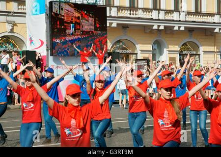 Russia. Schoolchildren perform song and dance routines on Nevsky Prospekt during St. Petersburg Annual City Day - Stock Photo