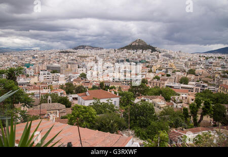 View of Athens and Lycabettus hill from the scenic neighborhood of Anafiotika in central Athens, Greece. - Stock Photo